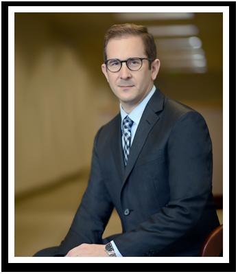 Counsel Andrew E. Saxon